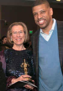 Ellie Shaw receiving the 2015 Ambassador of the Year Award with the Sacramento mayor, Kevin Johnson.